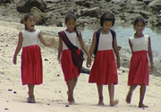 Primary school girls on beach in Samoa